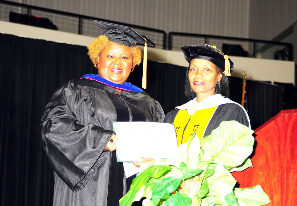 AKANE SIMPSON/The Gramblinite Graduation speaker Dr. LaQuieta Huey (left) receives a gift from Grambling High and Middle Magnet School principal, Dr Pamela Payne.
