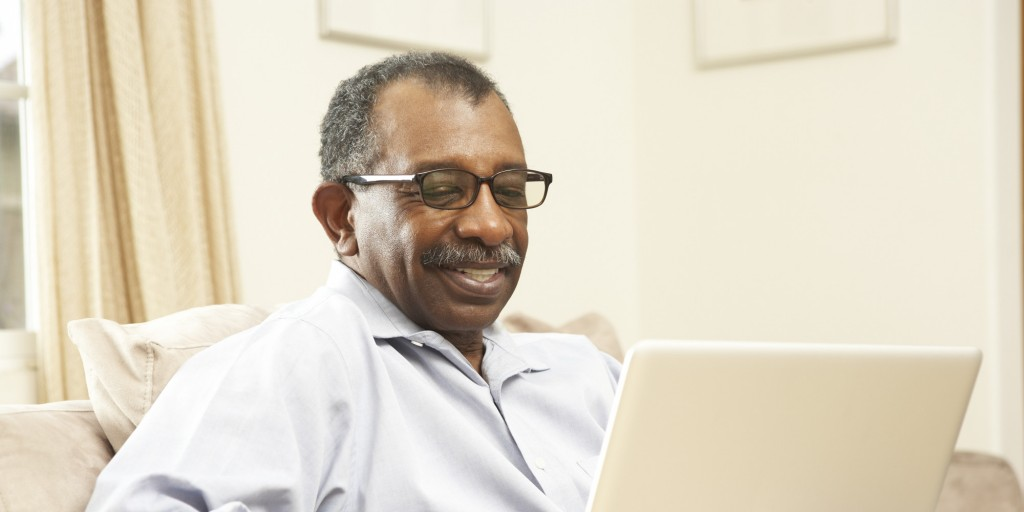 Senior African American man on a laptop