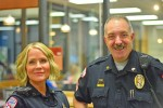 Law enforcement interacts over coffee
