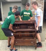 Lion athletes continue season after flood while helping victims