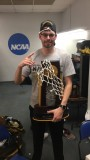 Grad wins division III hoops championship in first year as assistant coach