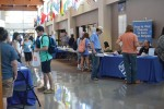 Students search for potential jobs at part-time job fair