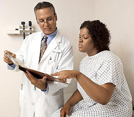 African American female patient with doctor