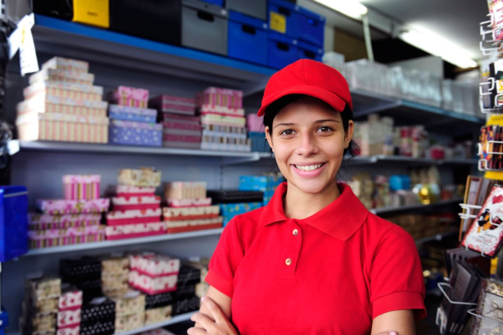 Young Latino worker at store