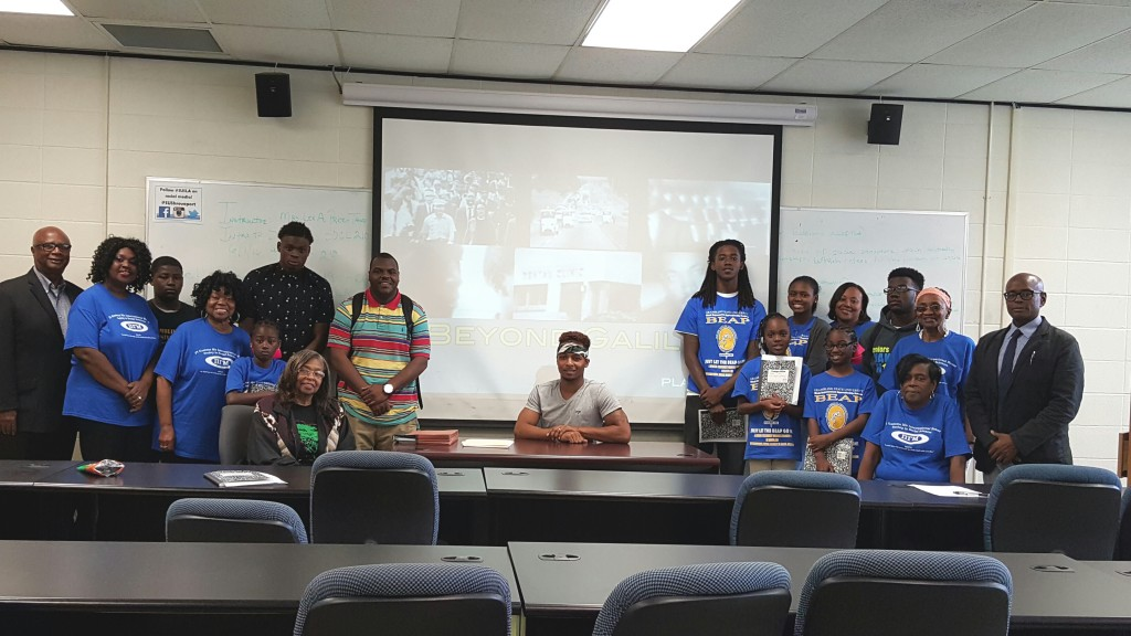Courtesy photo Members of Pi Gamma Mu and BEAPer's stand with training workshop host, Dr. Michael Hicks (far right).