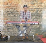 Guest musician plays at The Café