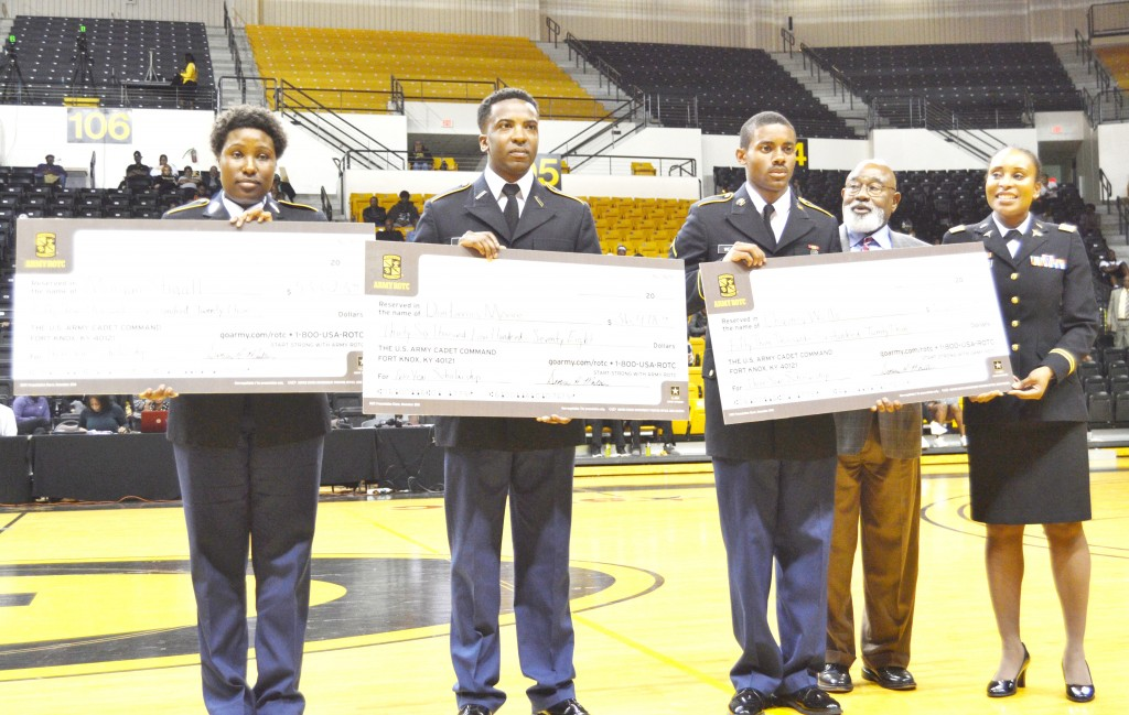 JACKIE JOHNSON/The Gramblinite Three Grambling State University Army ROTC cadets hold checks as Dr. Willie Larkin, GSU president, and Lt. Col. Denise Moultrie, professor of Military Science, looks on. The cadets include (l-r) Morgan Stigall, Dontavius Moore and Chauncey Wells.
