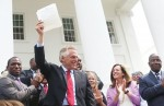 Gov. McAuliffe restores voting rights of 206,000 Virginians