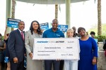 Andrew Gillum presents check to Florida Democrats, minority groups