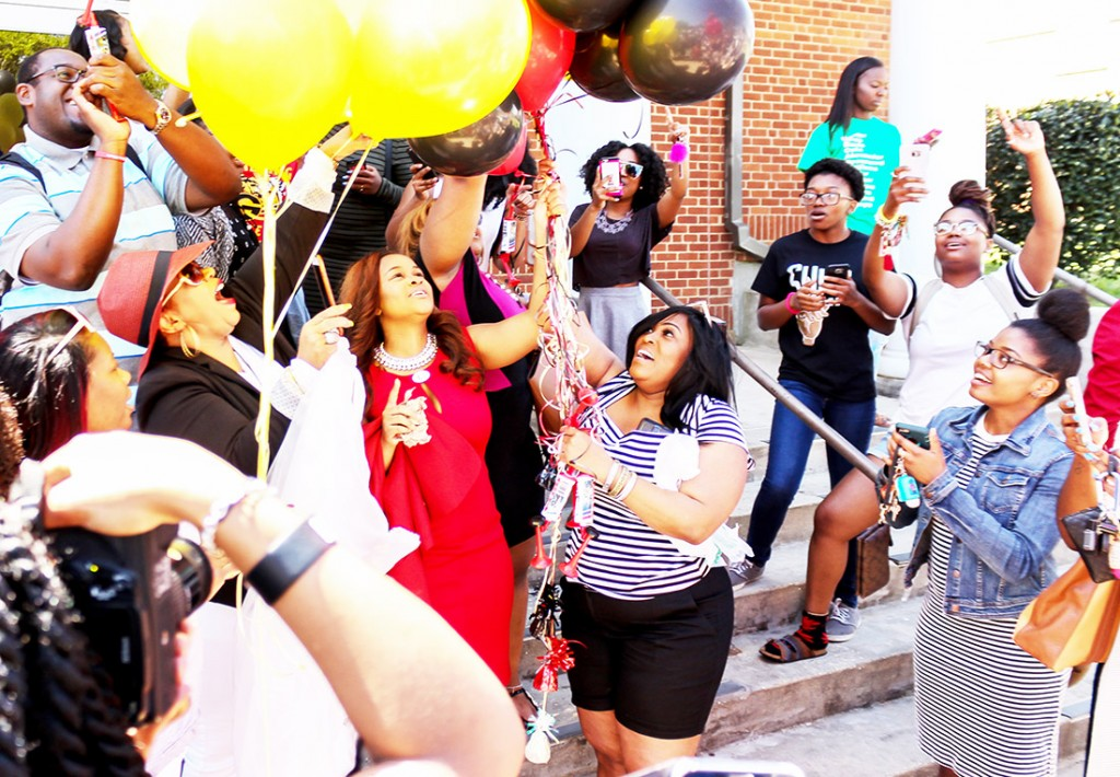 Miss GSU 2016-2017 Astra Watts (center) releases balloons after hearing her name announced as the winner.