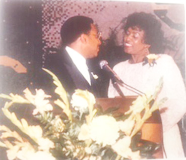 Courtesy photo Mrs. Mildred Moss stands with then GSU President Joseph B. Johnson in the Black and Gold Room.