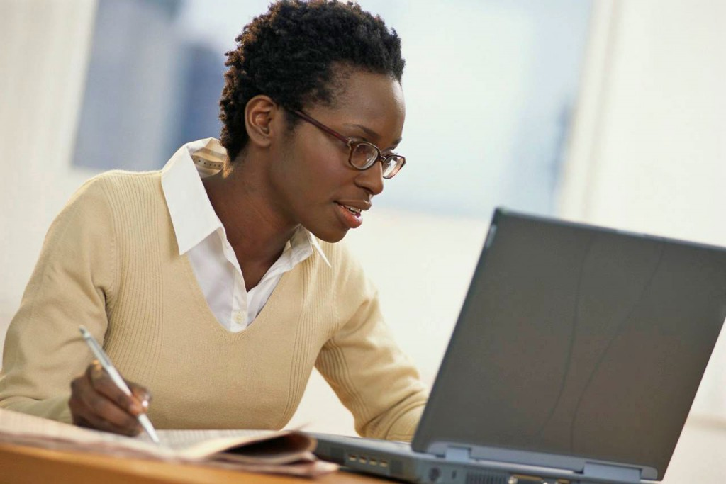 African American woman on a computer