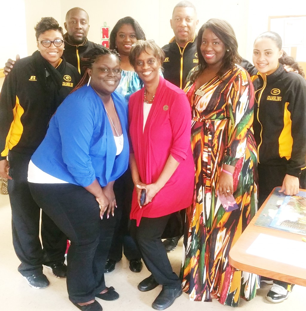 """Courtesy photo Coaches of the Lady Tigers basketball team take advantage of a """"photo op"""" with members of the Greater Grambling Chamber of Commerce."""