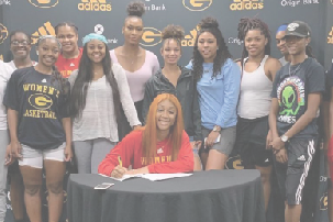 Former basketball standout inks international deal